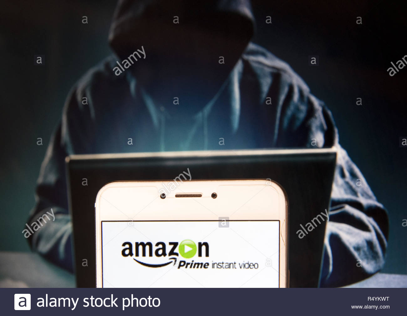 hong kong china 22nd nov 2018 american internet video on demand service owned by pany prime logo is seen on an android mobile device with a figure of hacker in the background credit miguel candelasopa imageszuma wirealamy live news R4YKWT