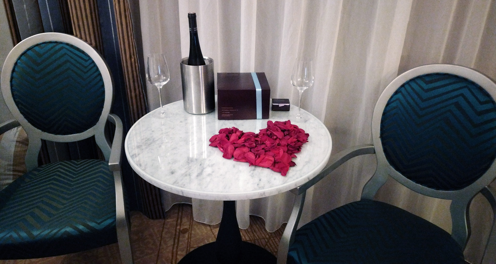 hotel aria budapest room table with chilled riesling wine