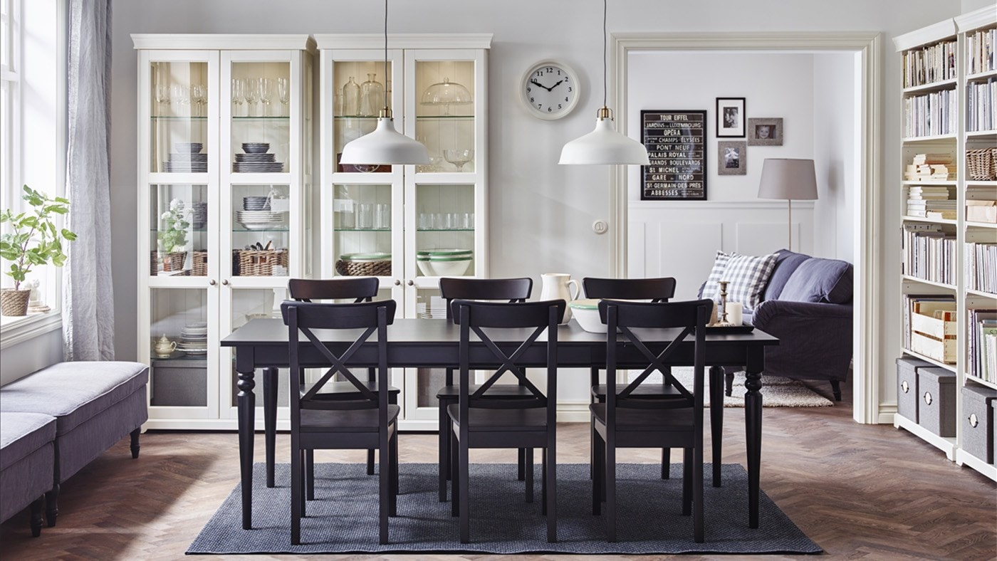 a large dining room with an extendable dining table and chai 9f c d96bd858e c3