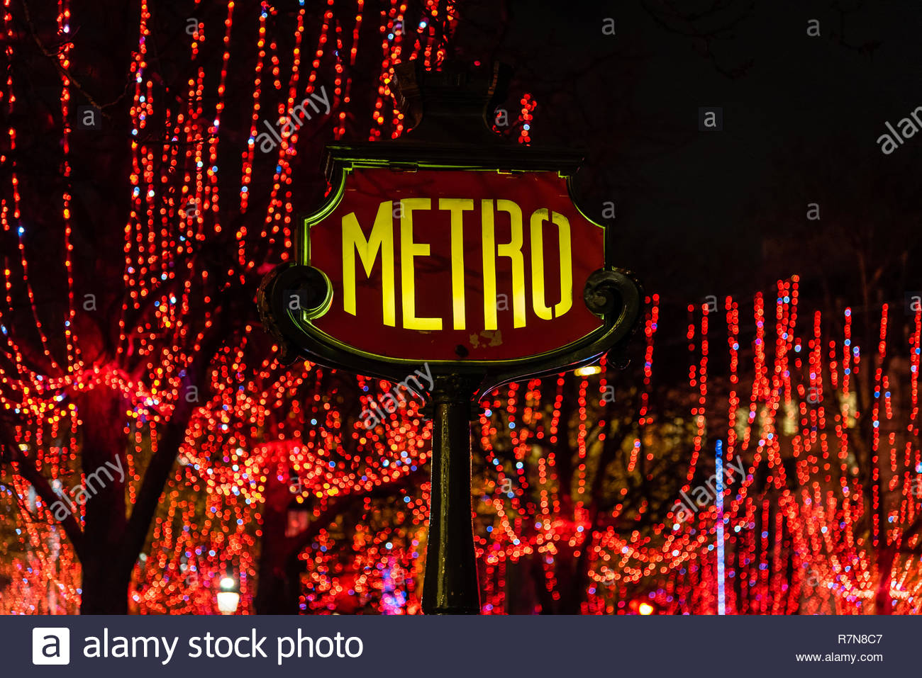 the metro sign and the christmas lights of champs elysee paris france R7N8C7