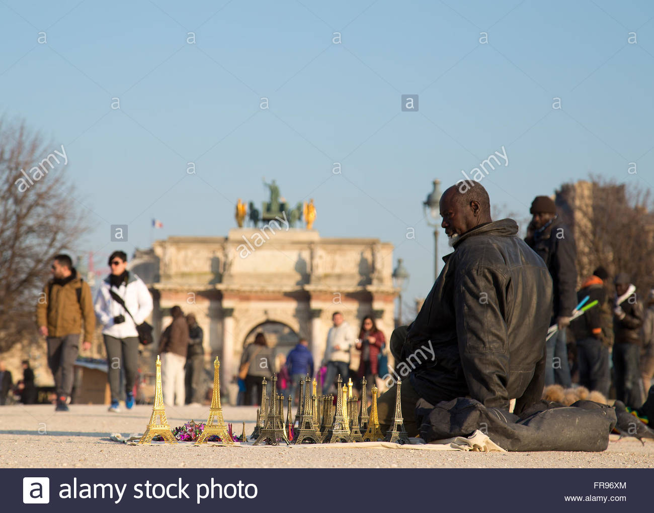 african migrant selling souvenirs in the jardin des tuileries in paris FR96XM
