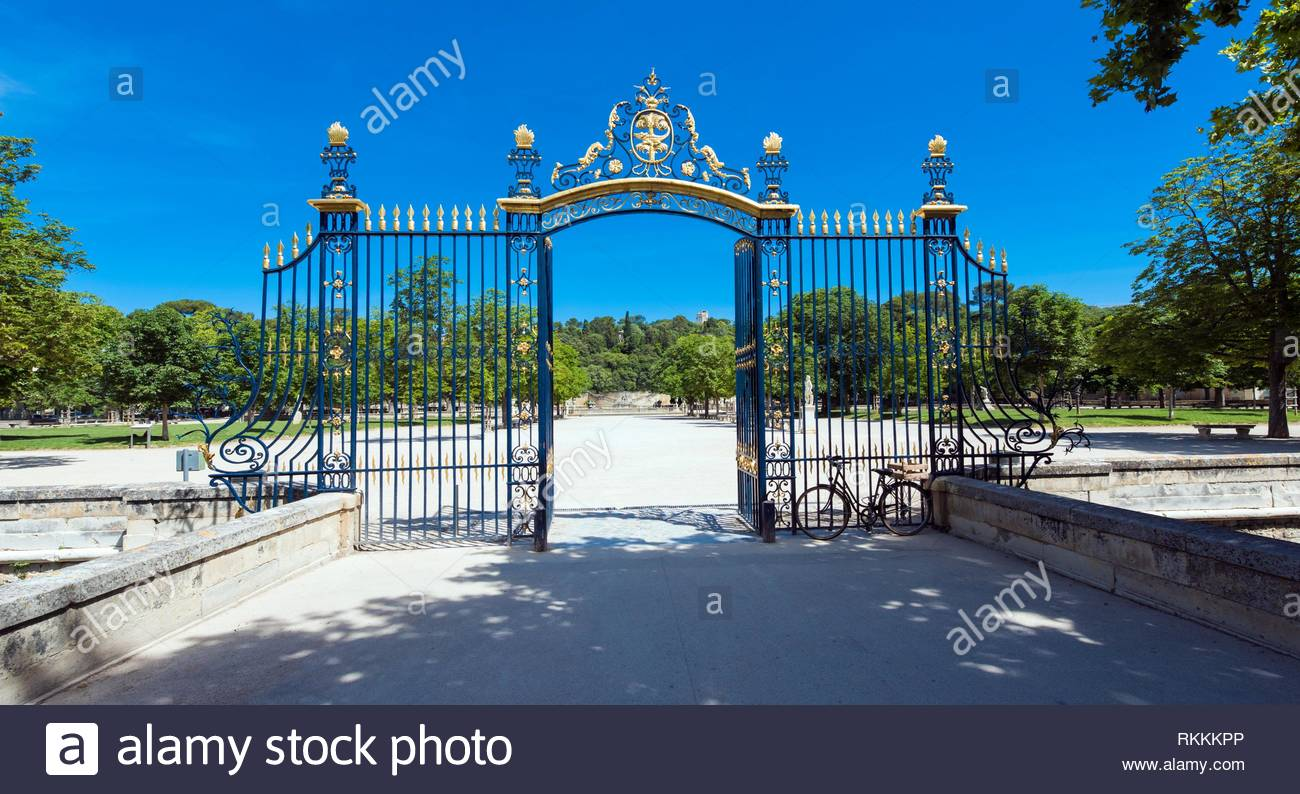 the entrance gate to the jardin de la fontaine nimes gard provence france europe RKKKPP