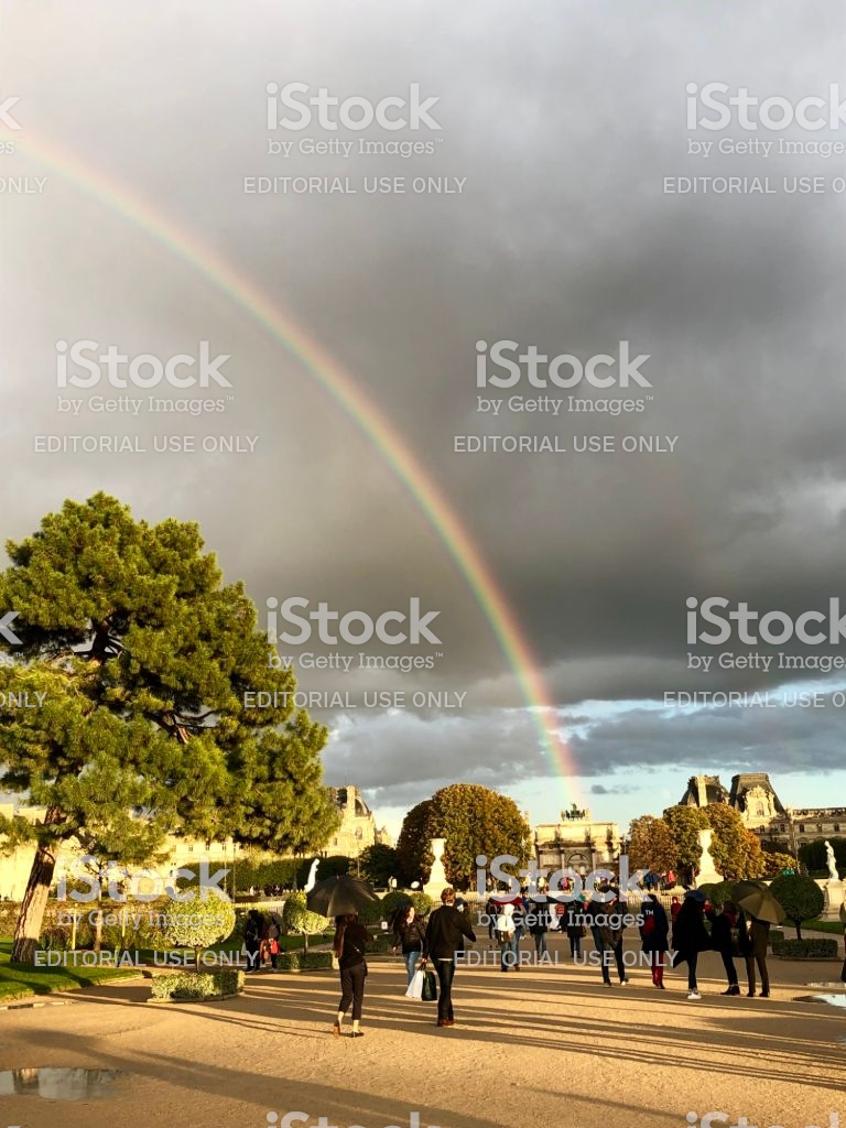 rainbow on arc de triomphe du carrousel near louvre in paris france gm